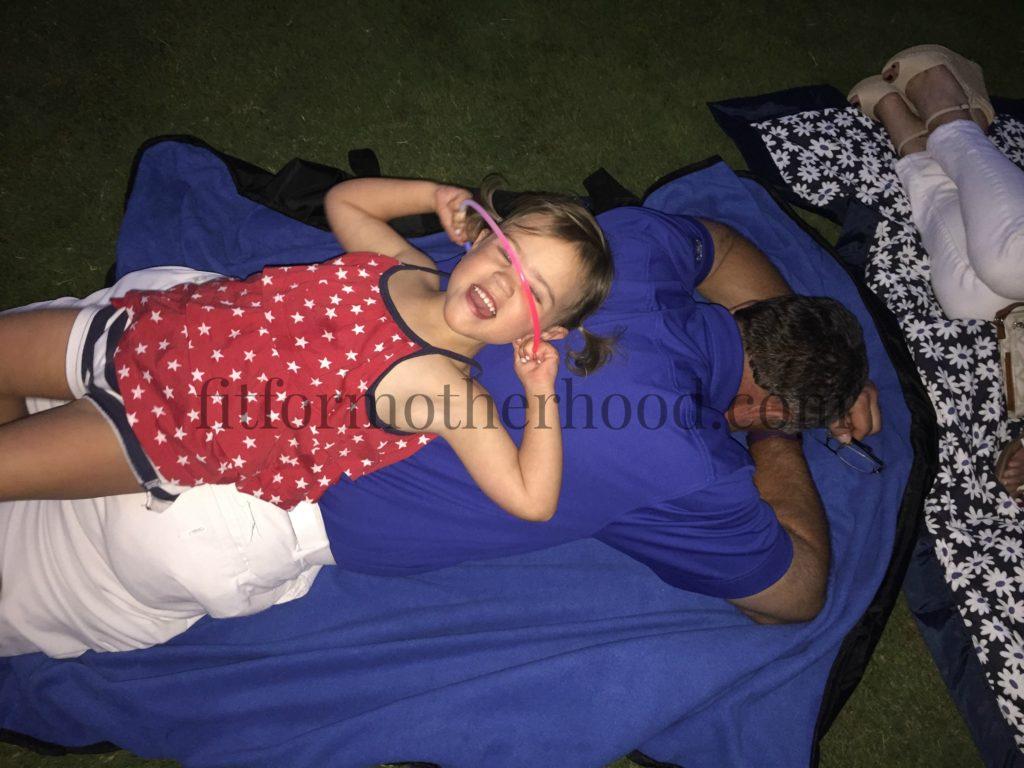june2016 fireworks mckenzie laying on papa