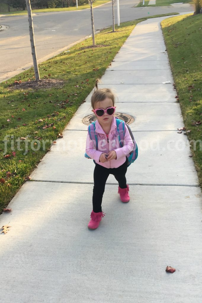 mckayla-walking-back-from-bus-stop-backpack